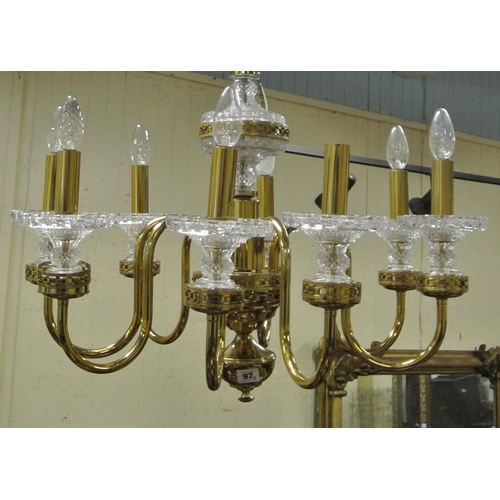 72 - Pair of ornate 8-branch brass chandeliers with S-shaped arms, and circular brass sconces...