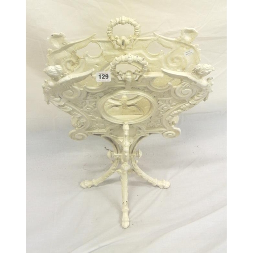 84 - Ornate cast iron magazine rack with figured and scroll decoration, on twist reeded column on quadrap...