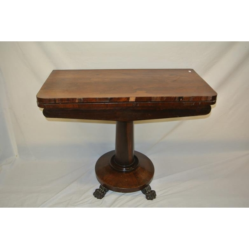 101 - William IV rosewood card table with swivel fold-over top, circular surface, on turned tapering colum...