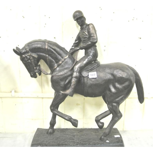 107 - Ornate bronzed figure of a horse and jockey, on oblong plinth...