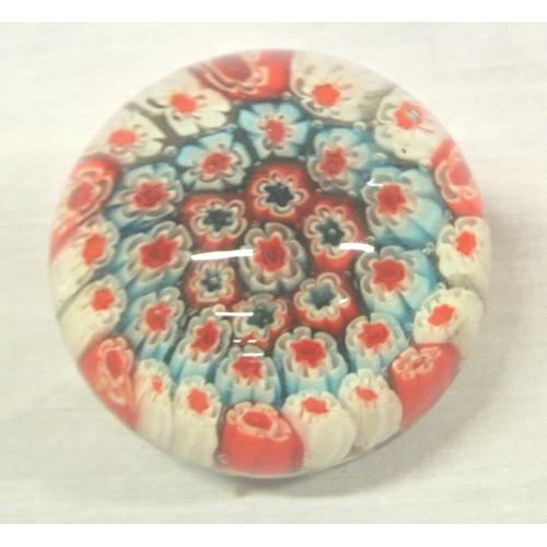 138 - Ornate mllifiori multi-coloured circular glass paperweight...