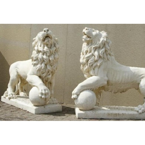 169 - Pair of large stone garden statues of the classical Medici Lions, standing with paws on balls or glo...