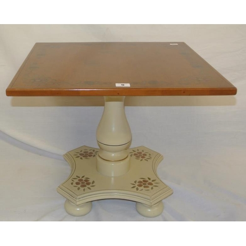 9 - Small walnut occasional table with foliate decoration, on column on circular feet...