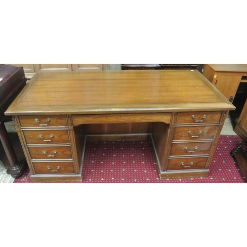 16 - Edwardian style pedestal desk with drawers and brass drop handles...