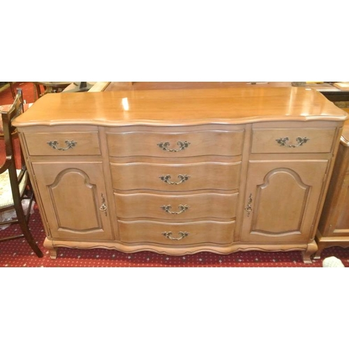 20 - American walnut cabinet with serpentine frieze, 4 central and 2 side drawers, with shelved presses....