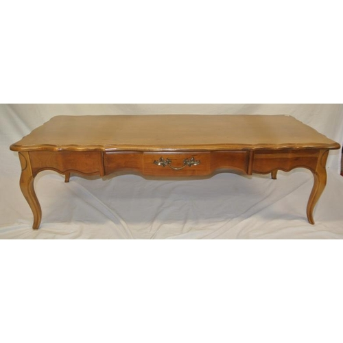 24 - American walnut oblong coffee table with serpentine borders, frieze drawer, on cabriole legs....