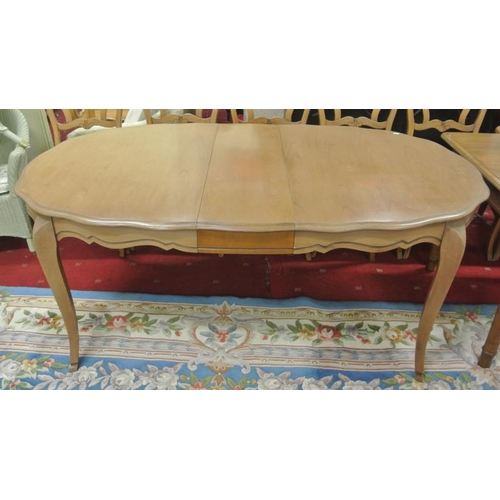 25 - American walnut extending oval dining table with serpentine borders, extra leaf, on cabriole legs...