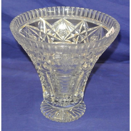 33 - Heavy cut glass flared flower vase with star decoration...