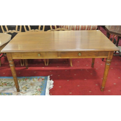 40 - American walnut dining table with frieze drawer, on turned legs...