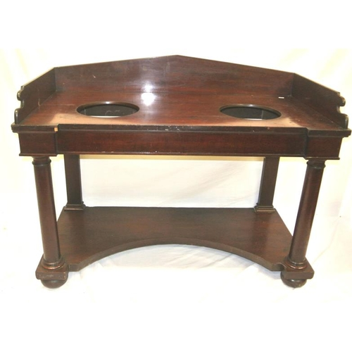 44 - Victorian mahogany breakfront hall table or washstand with angled back, on turned tapering legs...