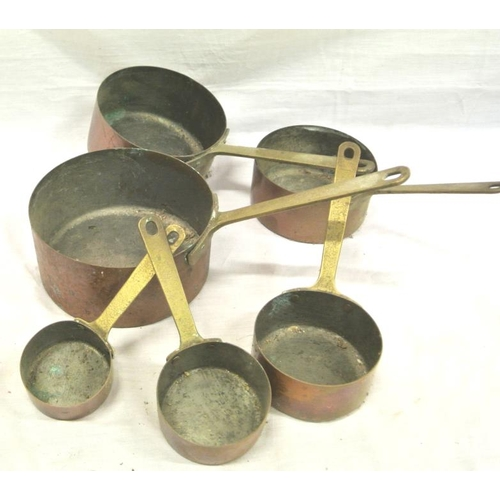 52 - Set of 6 copper saucepans with brass handles...