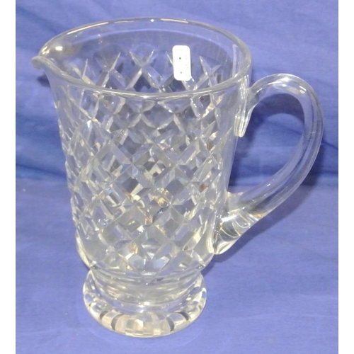 89 - Heavy crystal cut glass water jug with shaped handle and diamond cut...