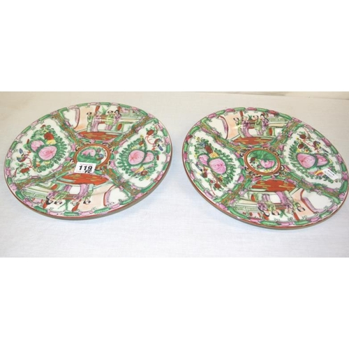 119 - Pair of Cantonese circular Famille Rose plates or plaques with ornate foliate and figured decoration...