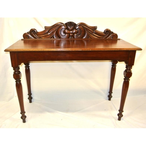 135 - Victorian mahogany hall or side table with scroll back, raised on turned tapering legs...