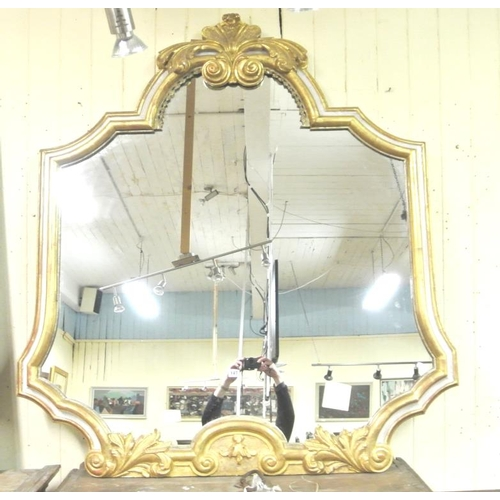147 - Large Dutch gilt framed baroque mirror c 1700 shaped and with ornate scroll decoration 140 - 130cm...