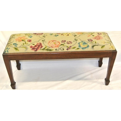 148 - Oblong Edwardian stool or window seat with foliate needlework, on tapering legs...