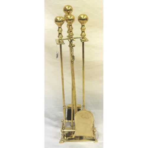 157 - Brass companion set with ball shaped tops on stand...