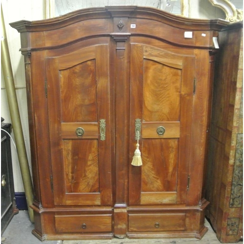 160 - Swiss 'Bodensee' cupboard with serpentine shape top and paneled doors, shelved interior, 2 drawers u...