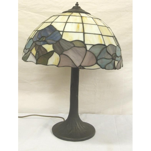 186 - Ornate Tiffany lamp with coloured shade and shaped base...
