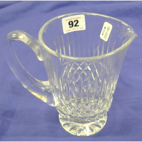 92 - Waterford crystal cut glass water jug with faceted cut and shaped handle...