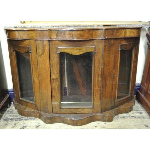 20 - Rosewood serpentine fronted chiffonier cabinet with presses with glazed doors on serpentine base...