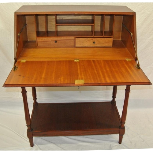 21 - Modern bureau with drop-down front, fitted with drawers and shelving, 2 drawers under, on turned col...