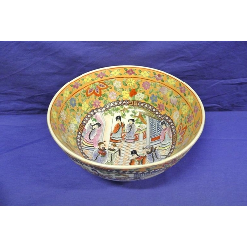 48 - Circular Cantonese flower bowl decorated with figures and foliage...