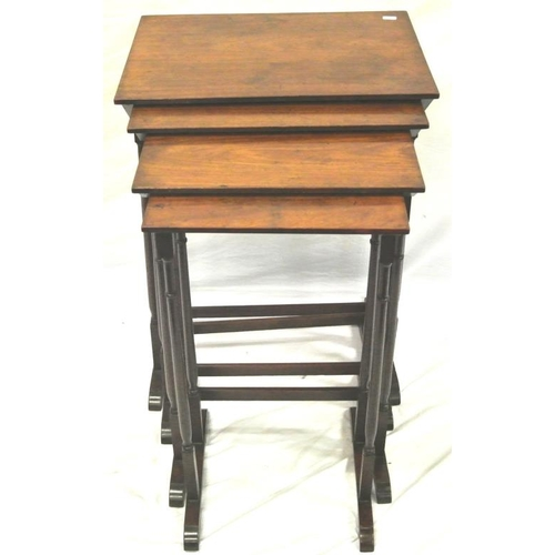26 - Edwardian mahogany nest of 4 tables of graduating sizes with spindle legs, on bracket feet...