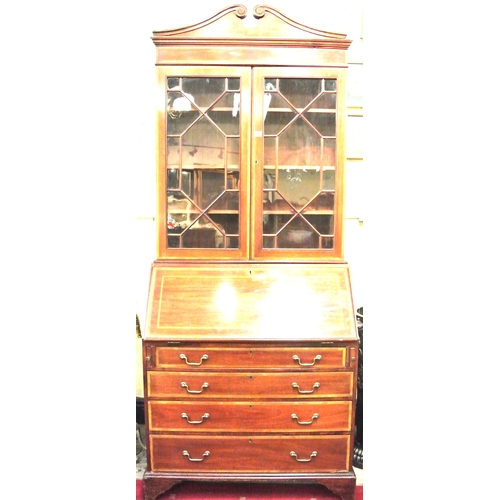 55 - Edwardian Sheraton style inlaid and crossbanded bureau bookcase with scroll arch pediment, glazed in...