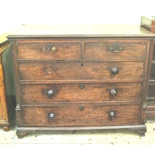 25 - Georgian mahogany chest of two short and three long drawers with reeded corners on bracket feet...
