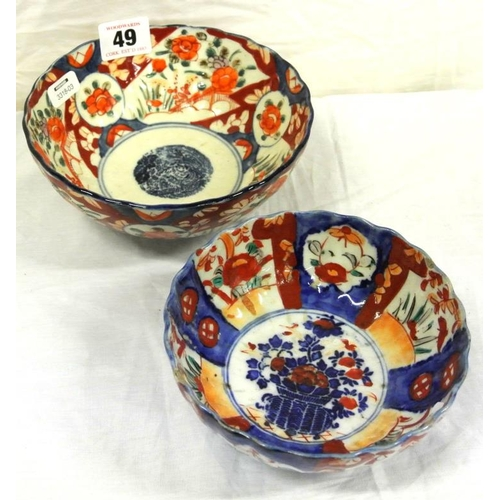 49 - Two Imari circular bowls with scalloped borders and foliate decoration...