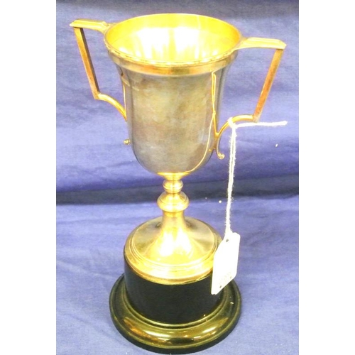25 - Birmingham silver trophy cup with shaped handles, on circular spreading base. 1921 20cm high...
