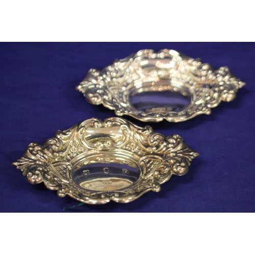 31 - Pair of Birmingham silver oval small dishes with ornate gadroon and scroll decoration, dated 1977, 1...