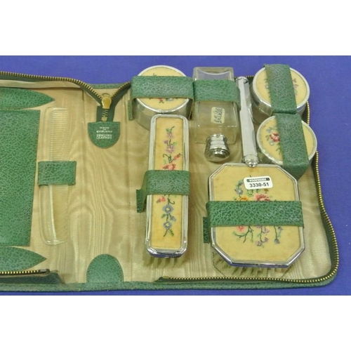 6 - Ornate vanity set with silverplated borders in box...