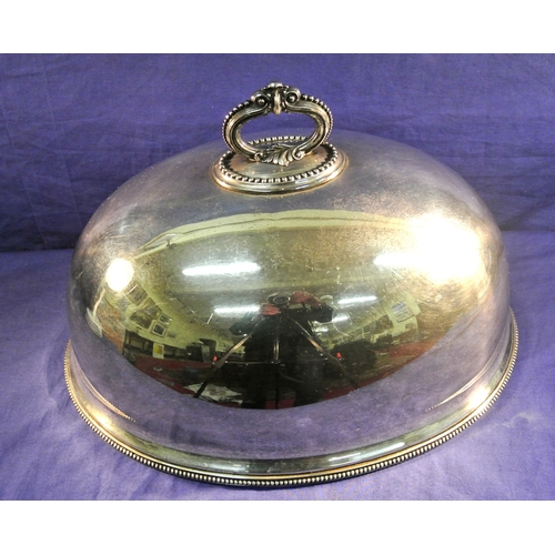 22 - Large silver plated domed dish cover of oval shape with decorated handle...