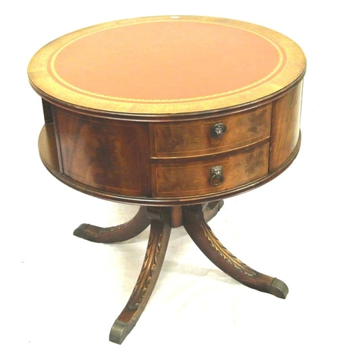 35 - Edwardian mahogany circular drum table with leatherette inset, bowed drawers with lionmask drop hand...