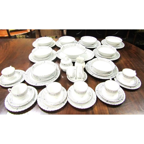22 - Oriental fifty eight piece dinner service with wavy rims and foliate decoration...