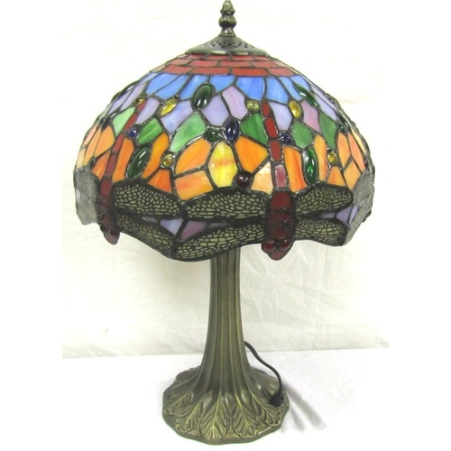 39 - Tiffany style electric lamp with shaped leaf decorated column and multi-coloured shade...