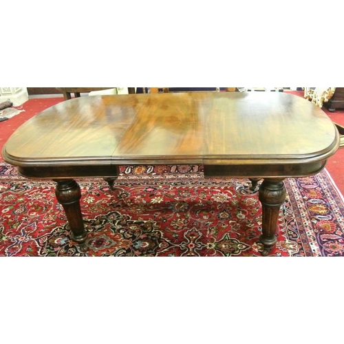 25 - Victorian mahogany D-end extending dining table with extra leaf inset, raised on turned reeded taper...