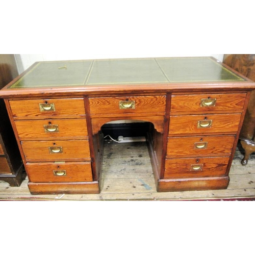 36 - Edwardian oak pedestal desk with leatherette top, drawers with recess brass handles, on plinths...