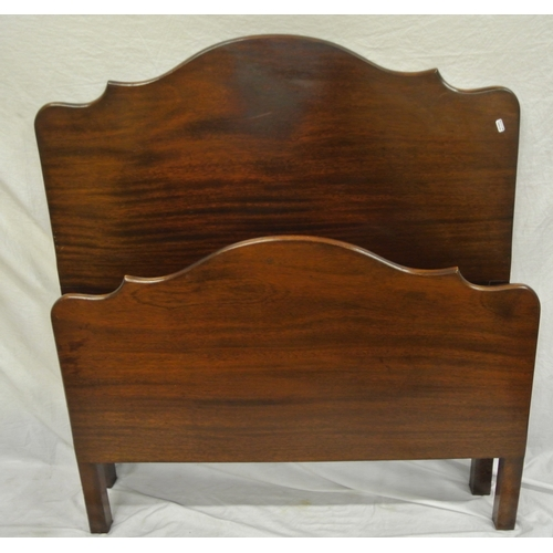 5 - Two pairs of mahogany bed ends and shaped tops and side irons...