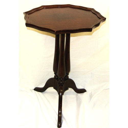 31 - Victorian style mahogany occasional table with raised shaped borders, triple columns, on tripod...