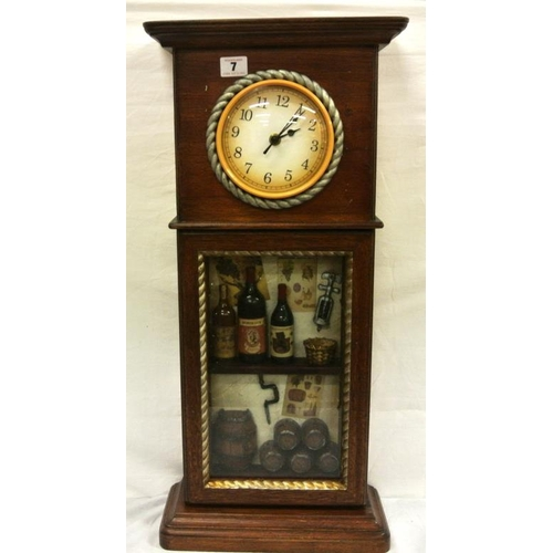 4 - Cased replica clock with miniature bottles and casks