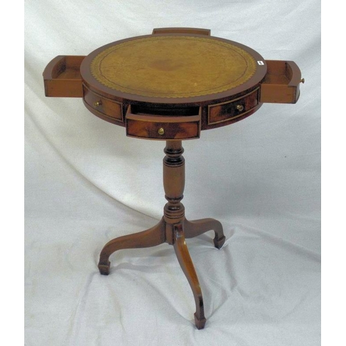 11 - Edwardian mahogany circular drum occasional table with leatherette inset, bow fronted drawers, on tu...