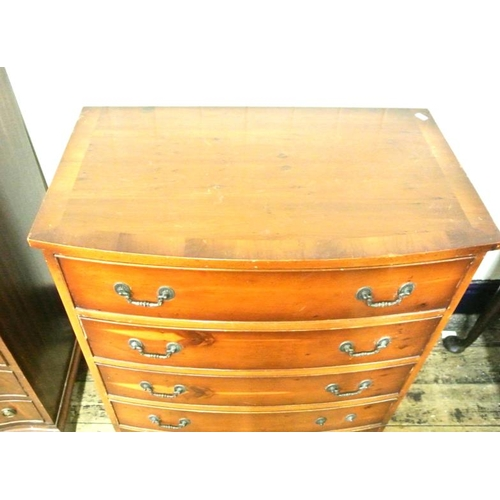 15 - Edwardian yew bow fronted chest of four drawers with drop handles and bracket feet