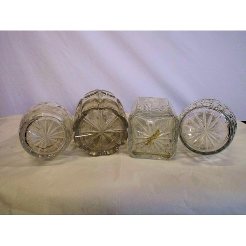 22 - Four assorted glass decanters with shaped stoppers