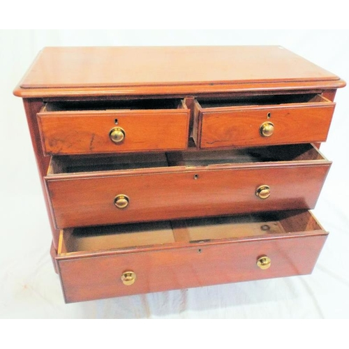 30 - Edwardian mahogany chest of two short and two long drawers with circular brass handles and escutcheo...