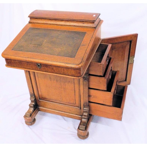 34 - Victorian oak davenport with domed lift-up top, writing slope with leatherette top, interior lined w...