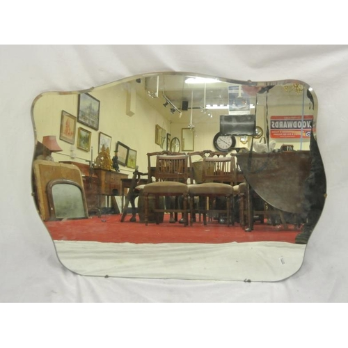 47 - Art deco style bevelled glass wall mirror with serpentine shaped borders