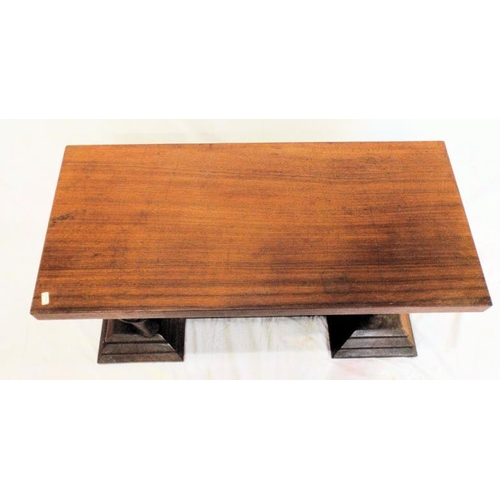 59 - Indian oblong mahogany occasional table with carved lion-shaped columns, on stepped bases